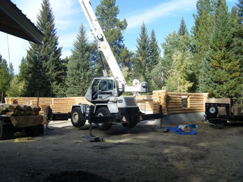 Crane setting handcrafted log walls