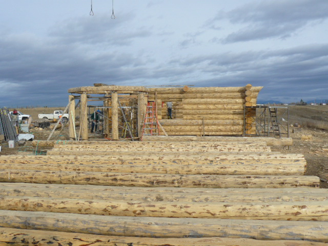 View of log walls, turret, and logs waiting to be put up, 11-30-09