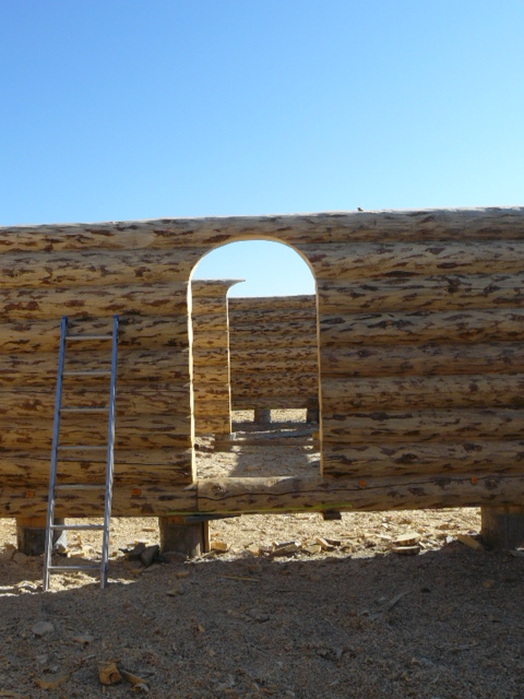 Interior log wall with archway